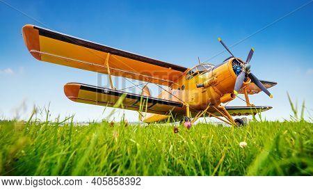 Historical Aircraft On A Meadow Against A Blue Sky