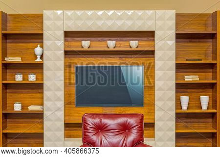Lcd Tv At Wooden Shelf In Living Room