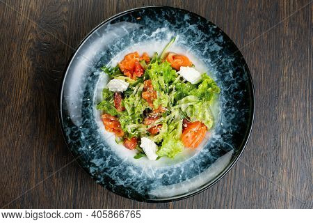 Greek Salad Of Tomatoes, Pickled Peppers, Cucumbers, Lettuce And Feta Cheese. Greek Salad With Olive