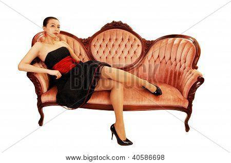 Asian Girl Sitting On Sofa.