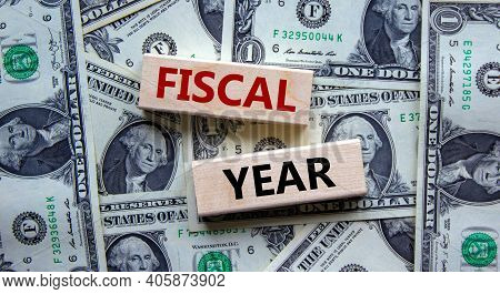 Fiscal Year Symbol. Concept Words 'fiscal Year' On Wooden Blocks On A Beautiful Background From Doll