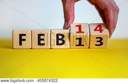 February 14 Valentines Day Symbol. Hand Turns Cubes And Changes The Word 'feb 13' To 'feb 14'. Beaut