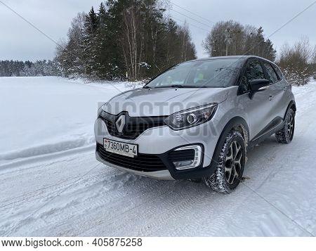 Grodno, Belarus-01.31.2021: Renault Capture Or Renault Captur Suv On A Winter Road Against The Backg