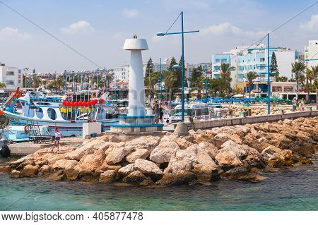 Ayia Napa, Cyprus - June 12, 2018: Agia Napa Marina View With Moored Boats And White Lighthouse Towe