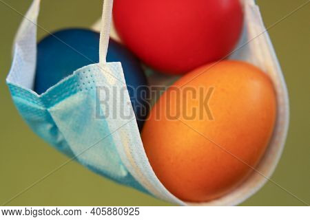 Isolated Colored Painted Easter Eggs In Surgical Mask, A Symbol Of Coronavirus Pandemic. Safety Firs