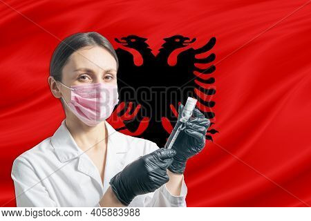 Girl Doctor Prepares Vaccination Against The Background Of The Albania Flag. Vaccination Concept Alb