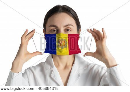 Respirator With Flag Of Andorra Doctor Puts On Medical Face Mask Isolated On White Background