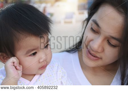 Close Up Portrait Of Happy Asian Mother And Daughter. Asian Woman And Little Toddler Girl In The Pla