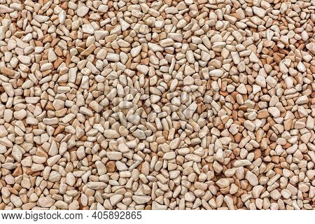 Small Naturally Polished Gray Rock Pebbles Background