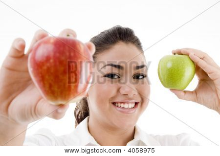 Young Attractive Model Showing Green And Red Apple