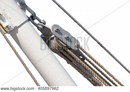 Metallic Pulley Block And Ropes On White Background