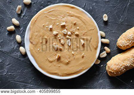 American Traditional Peanut Butter With Salted Peanuts. Breakfast Ideas. Gluten Free Bread Sticks Wi