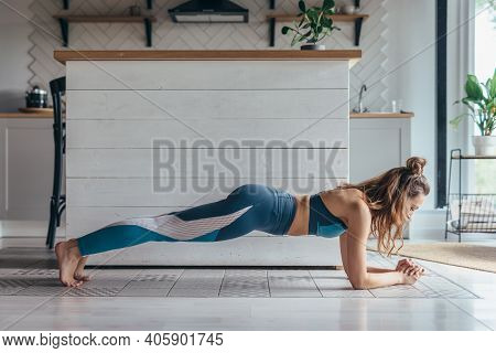 Fit Woman Doing Plank Exercise Workout At Home.