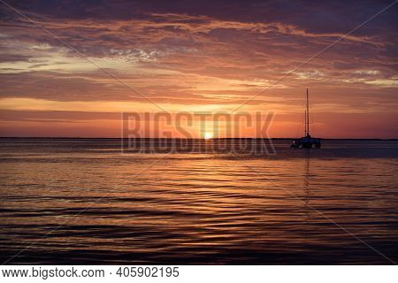 Sea Boats At Sunset. Ocean Yacht Sailing On Water. Yachting