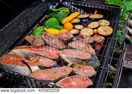 Salmon Or Trout Red Fish Fillet On Grill (bbq, Barbecue) Cooked On Fire. Seafood Steak Filet Roast F