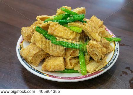 A Close Up Of Taiwan Traditional Stir-fried Tofu Skin (bean Curd Sheet), Taiwanese Food On Wood Tabl