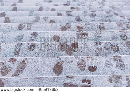 A Picture Of Some Footsteps In Snow On Some Stairs Outside