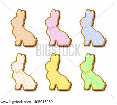 Set Of Easter Cookies In The Form Of Rabbits. Gingerbread Cookies With Colored Pastel Glaze Isolated