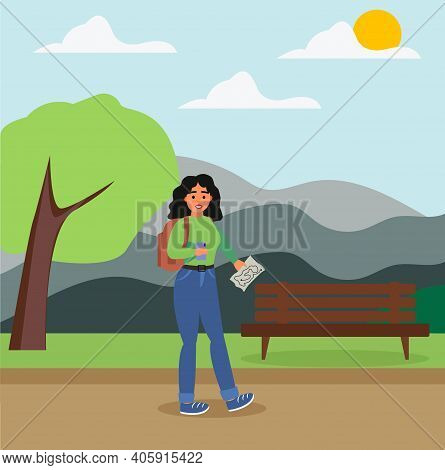 A Tourist Girl With A Backpack Holds A Map In Her Hands, A Tourist In The Park On The Street