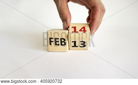 February 14 Valentines Day Symbol. Hand Turns The Cube And Changes The Word 'feb 13' To 'feb 14'. Be