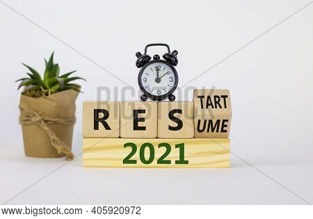2021 Resume And Restart Symbol. Turned A Cube And Changed Words '2021 Resume' To '2021 Restart'. Ala
