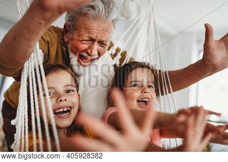 Family, Generation Love And People Concept. Happy Grandparent Having Fun With Children At Home