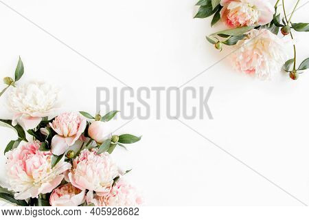 Border Frame Made Of Pink And Beige Peonies Flower And Isolated On White Background. Flat Lay, Top V