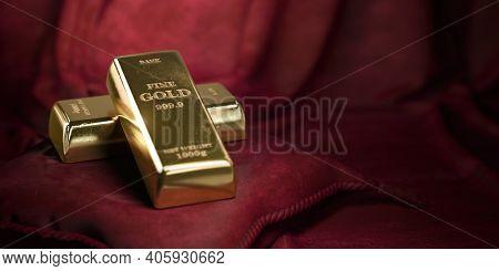Golden bars or ingots on red velvet pillow background. 3d illustration