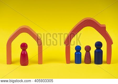Wooden Figures, Miniature People Family On Yellow Background. Divorce, Conflict Between Parents, Chi