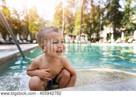 Little Cute Adorable Blond Playful Beautiful Caucasian Active Toodler Boy Enjoy Playing At Pool Edge