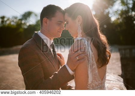 Bride And Groom Looking At Each Other And Smiling. Happy Newlywed Wedding Couple
