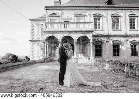 Bride And Groom Standing In Front Of Each Other And Embracing. Black And White