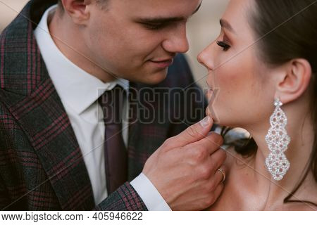 Groom Touching The Chin Of The Bride. Closeup Newlywed Portrait. Wedding Couple