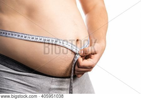 Fat Man Check Out His Body Fat With Measuring Tape For White Background