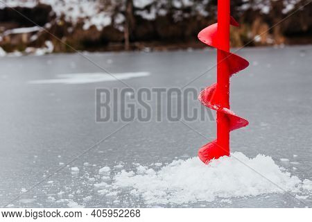 Drilling With Ice Screw. Ice Augers For Fishing. Ice Fishing On The River. Winter Fishing. Backgroun