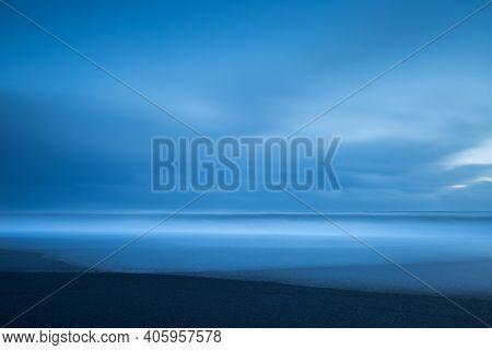Abstract Nature Background. Minimalistic Icelandic Landscape.  Beautiful Peaceful Black Volcanic Sand Beach. Serene Nature of Vatnajokull Jokulsarlon. Iceland.