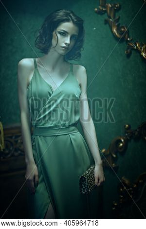 Magnificent brunette girl poses in vintage room with light haze. Beauty, fashion.