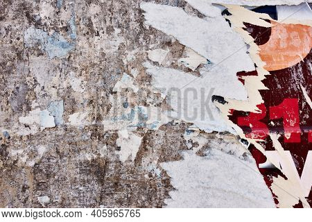 Torn bulletin board with scraps of posters - Texture and background
