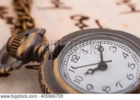 Vintage Pocket Watch Over A Manuscript Background