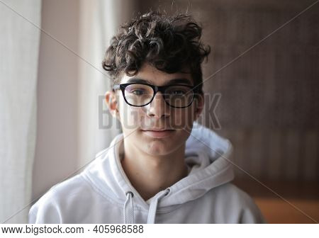 portrait of teenager with glasses