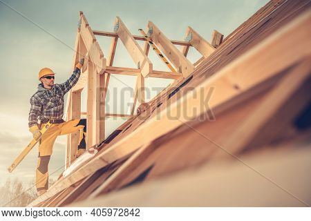 Construction Industry Theme. Caucasian Contractor Worker In His 40s With Sprit Level Tool In His Han