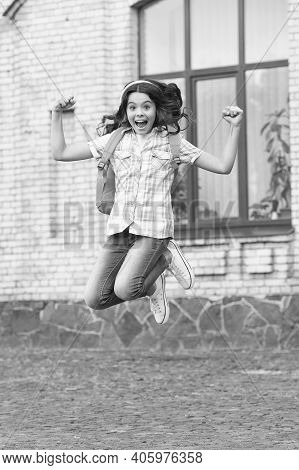 Aim High, Together We Will Fly. Happy Child Jump Outdoors. Active Childhood Development. Back To Sch