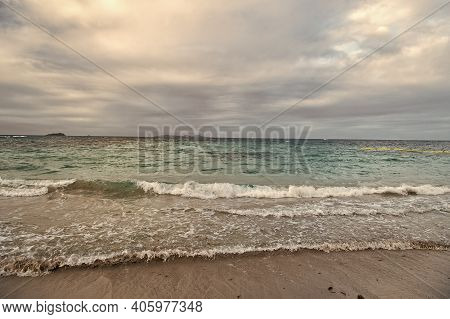 Beautiful Marine. Blue Sea On Cloudy Sky Background. Sea Waves On Sandy Beach. Sea Shore. Seascape.