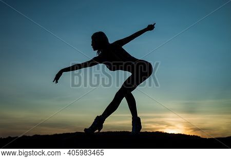 Ballerina. Woman Silhouette On Sky Background. Sense Of Freedom. Female Silhouette On Sunset. Woman