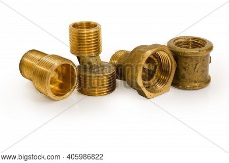 Brass Eccentric Connectors, Pipe Coupling And Connecting Pipe With Nut On A White Background, Close-