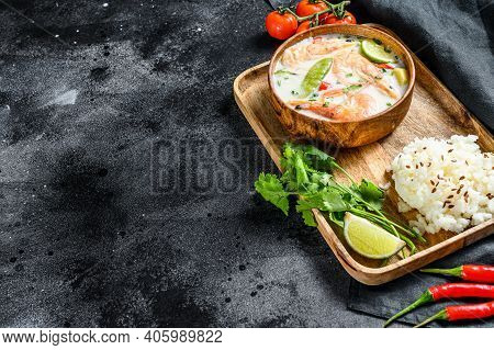 Tom Kha Gai. Creamy Coconut Soup With Chicken And Shrimp. Thai Food. Black Background. Top View. Cop
