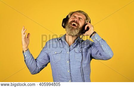 Music Beat. Noise Cancellation Function. Man Bearded Hipster Headphones Listening Music. Dj Hipster.