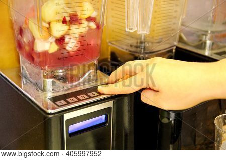 Using A Modern Electric Blender For Making A Healthy Smoothie With Fresh Fruit. Woman Is Making Smoo