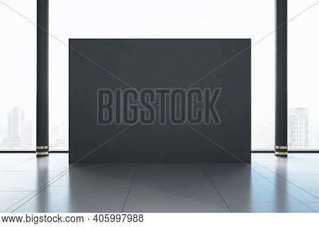 Minimalistic Gallery Room With Blank Gray Exhibition Stand And City View. Gallery And Presentation C