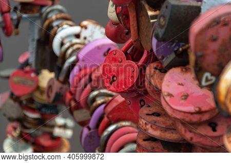 Many Heart-shaped Padlocks Hang On The Bridge